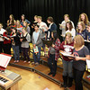 Rockport: Members of the Rockport High School Chorus, under the direction of Jim Davison, rehearse for their Winter Concert, which was held Thursday night. The Elementary School Band, Orchestra & Chorus will have their concert on Monday at 7 pm. Photo by Kate Glass/Gloucester Daily Times