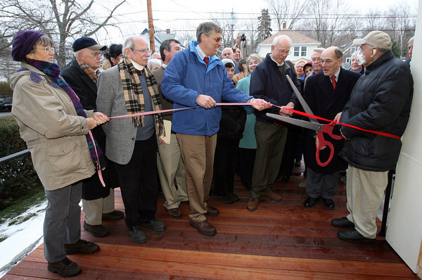 Rockport: Rockport Selectwoman Frances Fleming, Selectman Sandy Jacques, Jack Campbell, Peter Webber, and Bob Burbank watch as Rockport Selectman Andrew Heinze cuts the ribbon to officially open the Rockport Community House yesterday. The building has been under renovation since last winter. Photo by Kate Glass/Gloucester Daily Times