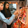 Gloucester: Charlotte Papp, 19, and Grace Papp, 13, look at some of their old Barbies, which their mom uses in a Barbie-themed holiday display. Photo by Kate Glass/Gloucester Daily Times
