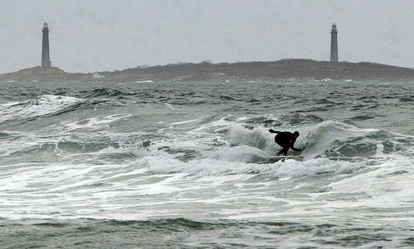 Rockport: Jared Frerk catches a wave off Long Beach yesterday afternoon. Photo by Kate Glass/Gloucester Daily Times