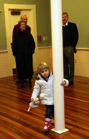Rockport: Aila Spencer, 3, twirls around a column at the Rockport Community Center as architect Wendall Kalsow gives a tour of the building during the dedication ceremony on Tuesday. Photo by Kate Glass/Gloucester Daily Times