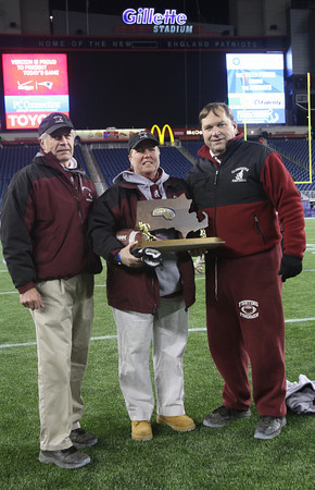 Gloucester: Gloucester football head coach Paul Ingram, Athletic Director and field hockey coach Kim Patience, and football coach Tom Walsh stand with the Super Bowl trophy at Gillette Stadium following the Fishermen's win this year. Ingram recently announced he will be retiring and Patience and Walsh will also be retiring, though Patience will remain as Athletic Director. Photo by Kate Glass/Gloucester Daily Times
