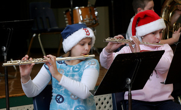 """Essex: Ashley Dort and Rebecca Braimon play """"Jingle Bells"""" with the Essex Elementary School band during their holiday concert on Thursday morning. Photo by Kate Glass/Gloucester Daily Times"""