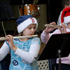 "Essex: Ashley Dort and Rebecca Braimon play ""Jingle Bells"" with the Essex Elementary School band during their holiday concert on Thursday morning. Photo by Kate Glass/Gloucester Daily Times"