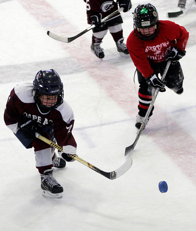 Gloucester: Zach Morris shoots the puck during the Glosta Lobsta Christmas Classic Cross-Ice Mite Hockey Tournament at the Talbot Rink on Thursday. Photo by Kate Glass/Gloucester Daily Times