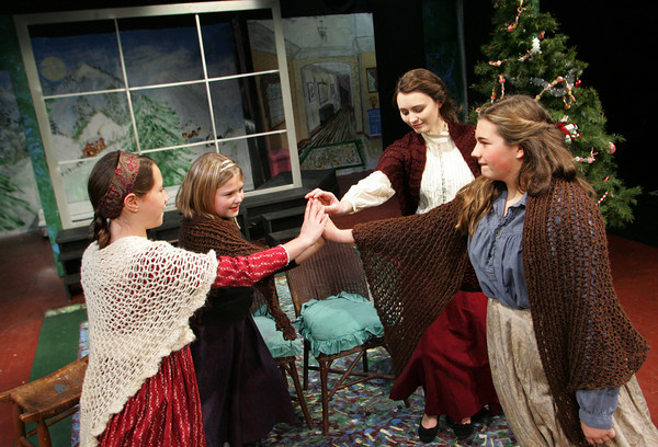 """Gloucester: From left, Corryln Ulrich as Amy, TS Burnham as Beth, Sarah Yetts as Meg, and Emma Donald as Meg rehearse their scene from """"Little Women"""" for the upcomming Holiday Delights show which will be performed Decemeber 16-19 at the Gloucester Stage Company.  Cape Ann students ages 6 to 16 will be perofrming scenes from classic holiday stories including Charles Dicken's """"A Christmas Carol"""", Henry Van Dykes' """"The Very best Kind of Chrismas Tree"""" and Louisa Mae Alcott's """"Little Women."""" Mary Muckenhoupt/Gloucester Daily Times"""