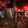 Gloucester: Gloucester Firefighters and Police respond to a rollover on Magnolia Avenue near the Cape Ann Industrial Park last night. The driver, who was the only person in the vehicle, was not injured. The road was closed briefly while the vehicle was removed from the scene. Photo by Kate Glass/Gloucester Daily Times