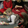 Essex: Alanna Fitzgerald, 8, left, of Magnolia laughs with her friend Kammie Reader, 8, of Essex while enjoying some yummy treats during the Nutcracker Party at the TOHP Burnham Library Saturday afternoon. Mary Muckenhoupt/Gloucester Daily Times