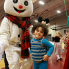 Gloucester: Marley Castillo, 3, of Gloucester looks for her mom after meeting Frosty at the Docksiders Disney character buffet breakfast at Gloucester High School Saturday morning.  The fundraiser breakfast offered live music with Santa and 15 Disney characters for kids to meet. The Gloucester High School Docksiders are raising money for their trip to Paris in 2012. Mary Muckenhoupt/Gloucester Daily Times