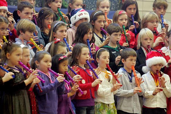 manchester: the third graders at Manchester Memorial elementary School play Christmas songs on their recorders during the Holiday COncert in the school's gym Friday morning. Mary Muckenhoupt/Gloucester Daily Times