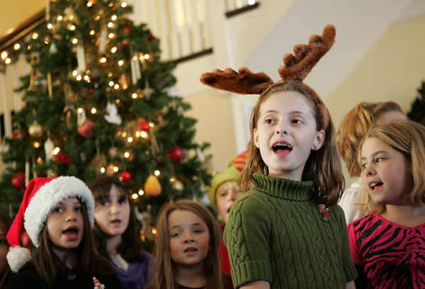 """Rockport: Madolin Beaulieu, a forth grader a Rockport Elementary School, sings """"Beautiful"""" by Carol King with the forth and fifth grade chorus for Rockport Rotary members at the Emerson inn Thursday afternoon. The chorus, diected by Jim Davison, sang a few holiday selections before heading back to school to finish up the day. Mary Muckenhoupt/Gloucester Daily Times"""