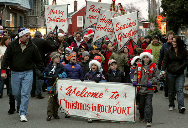 Rockport: The Rockport Boy Scouts lead the way as Santa heads down Bearskin Neck in an fire truck behind them Saturday afternoon.  Santa arrived to Tuna Wharf by boat for the annual tree lighting. Mary Muckenhoupt/Gloucester Daily Times