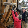 Essex: Harold Burnham, with the help of Bernie Powers, secures the frame that was just put in place on the schooner Ardelle being built at H.A. Burnham Boat Building and Design Saturday afternoon.  Mary Muckenhoupt/Gloucester Daily Times