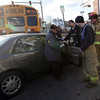 Gloucester: Gloucester Firefighters speak with the driver of a vehicle that was involved in an accident with a Gloucester school bus near the intersection of Western Avenue and Centennial Avenue yesterday afternoon. No students were on the bus at the time of the crash and no injuries were reported. Photo by Kate Glass/Gloucester Daily Times