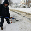 Manchester: Brian Flatley shovels out the fire hydrant in front of his home on Lincoln Street in Manchester yesterday. Photo by Kate Glass/ Gloucester Daily Times