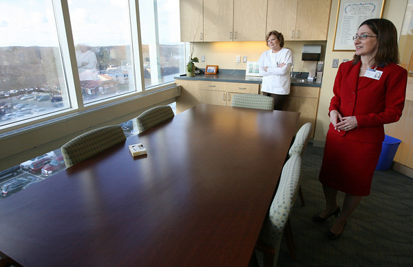 Gloucester: Cindy Donaldson, President of Addison Gilbert Hospital, and JoAnne Gibbs, RN, admire the view from one of the hospital's conference rooms. Photo by Kate Glass/Gloucester Daily Times