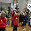Manchester: Giuseppe Tra reaches his hands out to catch some fake snow during Toe Jam Puppet Band's winter variety show put on by the Manchester Public Library at the First Parish Chapel Saturday morning. Mary Muckenhoupt/Gloucester Daily Times