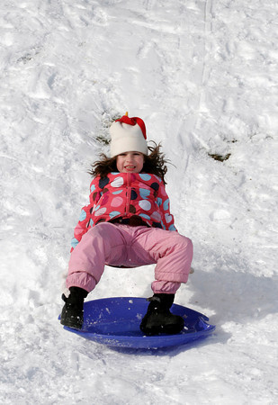 Essex: Haley Jackson, 6, of Essex flies off her sled after hitting a jump behind Essex Town Hall yesterday afternoon. Photo by Kate Glass/Gloucester Daily Times