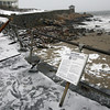 Rockport: The metal railing at Front Beach was destroyed by debris washed up in the storm during high tide early Monday morning. Photo by Kate Glass/Gloucester Daily Times