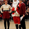 Manchester: Assistant Principal Paul Murphy interviews Santa and Mrs. Claus, played by Drew Gosnell and Molly Friedman, during a holiday assembly at Manchester Essex Regional Middle and High School on Thursday. Photo by Kate Glass/Gloucester Daily Times