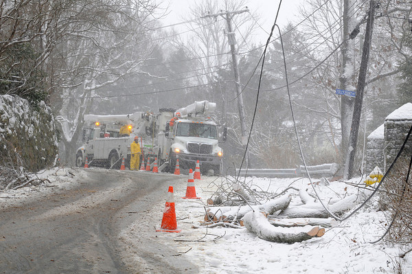 Gloucester: Work crews repair downed power lines in Lanesville next to Folly Point Rd Monday morning. Desi Smith/Gloucester Daily Times. December 27,3010.