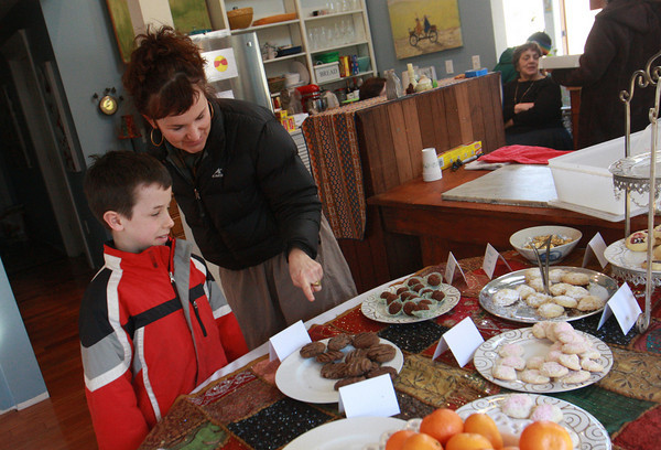 Rockport: Anne Rockwell and her son Luke Simpson, 10, of Rockport look over their choices at the bake sale at the home of Gina Fettig Saturday afternoon. The bake sale was to raise money for the families who was displaced after a fire destroyed a duplex in Rockport at the end of November.  The Fettig family lost their home to fire in Feb. 2008 and they have since rebuilt their home and Gina has started her own baking company. This is her way of giving back, she said. Mary Muckenhoupt/Gloucester Daily Times
