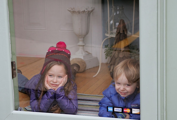 Rockport: Fiona Hazel. 5, and her brother Beckett, 3, look out the window of Milk and Honey while their mother does some shopping Friday afternoon. Mary Muckenhoupt/Gloucester Daily Times
