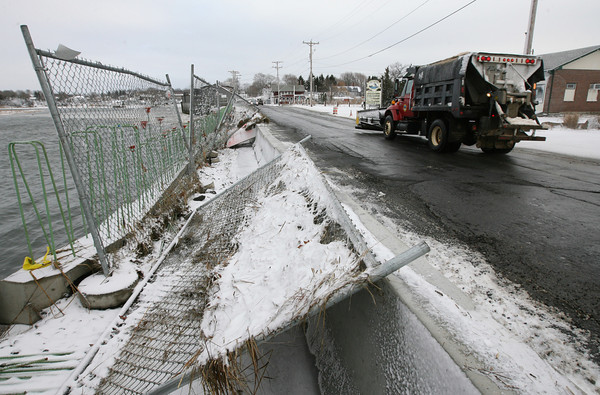 Essex: Flood waters knocked over the chain link fence along the Causeway construction project in Essex. Photo by Kate Glass/Gloucester Daily Times