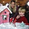 Gloucester: Will Virgilio, 4, of Gloucester shows his mom, Kristen, some of the gindgerbread houses on display at City Hall Saturday afternoon. The gingerbread house contest was judged Saturday monring as one of the Middle Street Walk events. Mary Muckenhoupt/Gloucester Daily Times