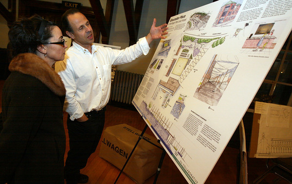 """Gloucester: Ed Shoucair of the Collaborative explains his proposal for the I4-C2 property to Christine Sidon during a reception at City Hall last night. Shoucair's proposal is """"Gloucester Place: A Heritage Park and Hotel."""" Photo by Kate Glass/Gloucester Daily Times"""