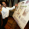 "Gloucester: Ed Shoucair of the Collaborative explains his proposal for the I4-C2 property to Christine Sidon during a reception at City Hall last night. Shoucair's proposal is ""Gloucester Place: A Heritage Park and Hotel."" Photo by Kate Glass/Gloucester Daily Times"
