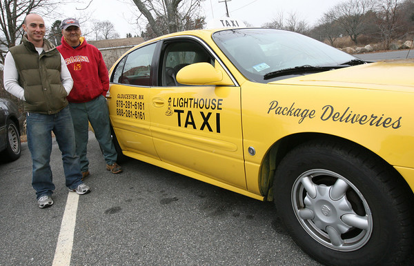 Gloucester: Adam Chin and his father, James Chin, are running Lighthouse Taxi. Photo by Kate Glass/Gloucester Daily Times
