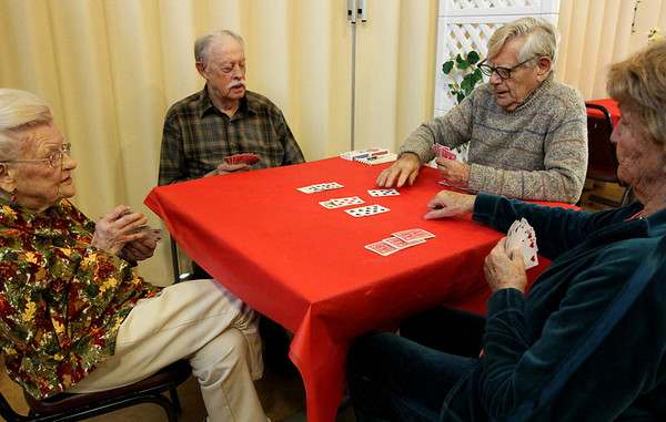 ALLEGRA BOVERMAN/Staff photo. Gloucester Daily Times. Gloucester: Playing bridge at the Rose Baker Senior Center on Thursday afternoon are, clockwise from far left: Marcella Ramey, Peter Jenner, Bruce Campbell and Phyllis Malone. They play every Thursday at 1 p.m. and welcome more participants to come play with them. Contact the center at 978-281-9765 or stop in at 6 Manuel F. Lewis Street, Gloucester.