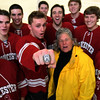 ALLEGRA BOVERMAN/Staff photo. Gloucester Daily Times. Gloucester: Kathy Milbury of Rockport brought her brother Michael MIlbury's Stanley Cup ring to the Gloucester high school varsity boys hockey team practice on Tuesday. Wearing the ring at center is co-captain Vincenzo Terranova, with Kathy Milbury next to him at right. Seniors on the team are with them.