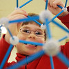 Damian Sorrenti, 7, enjoys his time piecing things together at a parent-run math program hosted at Rockport Elementary School on Saturday morning. Jesse Poole/Gloucester Daily Times Dec. 15, 2011