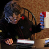 "ALLEGRA BOVERMAN/Staff photo. Gloucester Daily Times. Manchester: Manchester Public Library Director Dorothy Sieradzki, wearing a heavy sweater and fingerless gloves, reshelves books at the library on Thursday afternoon. The library lost its heat on Thursday so staff and visitors were bundled up for a while. She was reshelving books to help staff out while people were on vacation or out sick. She said she loves that, ""this is the fun part of the job,"" she said; it gets her moving around the library and being active, which came in handy while the heat was being fixed."