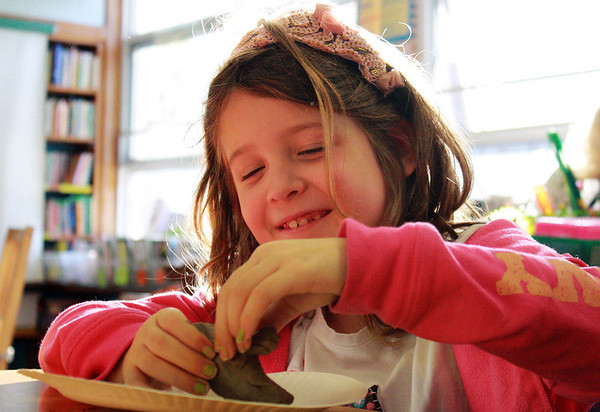 GLOUCESTER-Second grader Sofia Varga scolps a coral reef out of clay on Monday afternoon as park of a fun science event put on by Hightouch Hightech at West Parish Elementary School. Jesse Poole/Gloucester Daily Times Dec. 12, 2011