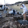 ALLEGRA BOVERMAN/Staff photo. Gloucester Daily Times. Essex: Creating the footing for stone pillars at a farm in Essex on Wednesday afternoon are Dana Beaulieu, right, owner of Stone Design of Groveland, and Rafe Penney, left, of Haverhill.