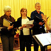 ALLEGRA BOVERMAN/Staff photo. Gloucester Daily Times. Gloucester: During the community Hanukkah party held at Temple Ahavat Achim in Gloucester on Tuesday evening. TAAShirim, the temple chorus, performed, led by Briana Polan.