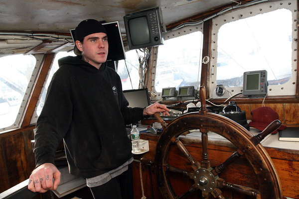 ALLEGRA BOVERMAN/Staff photo. Gloucester Daily Times. Gloucester: Charlie Williams of Gloucester, 25, aboard the trawler Lady Jane at the Gloucester Marine Railways. He will soon be out catching shrimp.