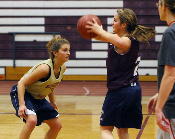 ALLEGRA BOVERMAN/Staff photo. Gloucester Daily Times. Gloucester: Gloucester Girls Varsity Basketball team members Heather Cain, left, and Julia Lamoureux during practice on Wednesday. Head coach Lori Sanborn is at far right.