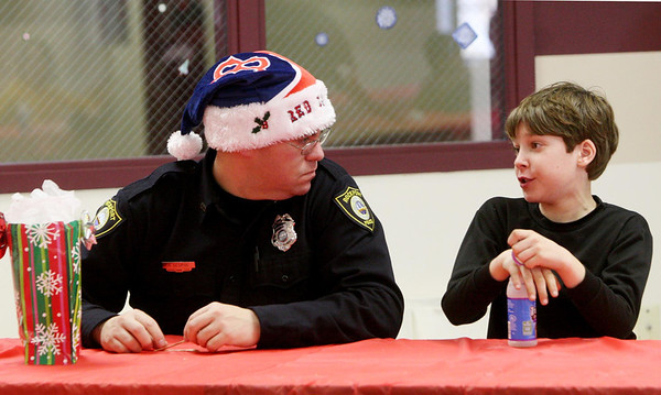 Courtesy photo/Gloucester Daily Times. Rockport: Members of the Rockport Police Department served lunch to Rockport Elementary School students on Friday. The school and police department have been planning to do this for a while and hope to make it a new tradition. From left are Patrolman Greg George chatting with fifth grader Thomas Tingley.