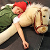 "ALLEGRA BOVERMAN/Staff photo. Gloucester Daily Times. Gloucester: During rehearsal of ""Holiday Delights,"" a holiday celebration of stories, songs and dance by the Gloucester Stage Youth Acting Workshops. A tired elf, Carter Donald, takes a siesta in the elves workshop."