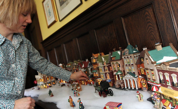 ALLEGRA BOVERMAN/Staff photo. Gloucester Daily Times. Rockport: Tamsen Endicott arranges the Christmas in the City display, two identical sets of which will be raffled, at The Captain's House Inn in preparation or the Seashells and Jingle Bells Inn and Home Kitchen Tour of Rockport which will be held on December 10th from 1- 6 p.m.