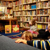 Devin Peavey, nearly 2, of Manchester, enjoys Mother Goose Story Time at the Manchester Public Library on Wednesday morning, as Sara Collins, children's librarian, read from a book about friendly garbagetruck driver. Jesse Poole/Gloucester Daily Times Dec. 07, 2011