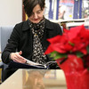ALLEGRA BOVERMAN/Staff photo. Gloucester Daily Times. Rockport: Marion Felder of Lanesville peacefully reads a magazine in the quiet reading room at Rockport Public Library on Tuesday afternoon. She loves this library because it's quiet and small.