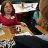 ALLEGRA BOVERMAN/Staff photo. Gloucester Daily Times. Gloucester: West Parish third grader Kasandra Buckley talks up her research about Pueblo Native Americans during her class's Native American presentation on Wednesday at the school. Each student in the class did extensive research about different Native American nations, wrote up their research, complete with illustrations, and created dioramas of how each nation set up their homes and then presented their findings to other students and parents.