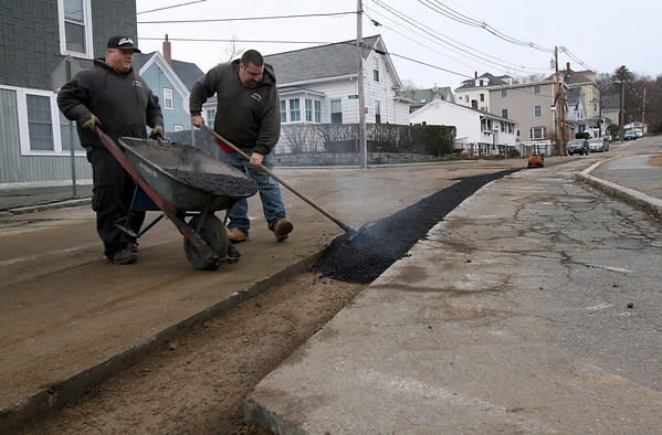 ALLEGRA BOVERMAN/Staff photographer. Gloucester Daily Times. Gloucester: From left: Bruce MacArthur and Kevin Levesque of McGinnis Paving of Beverly Farms, repave Webster Street where gas lines have just been worked on Tuesday afternoon.