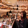 ALLEGRA BOVERMAN/Staff photo. Gloucester Daily Times. Gloucester: Vincent Orlando of Gloucester, right, and his granddaughter, Sarah-Jean Collins, 7, of Gloucester, examine details of the large village holiday display in Orlando's living room. Many members of the family, including Collins, help him to set this display up each year, and it's been growing steadily in size each year.