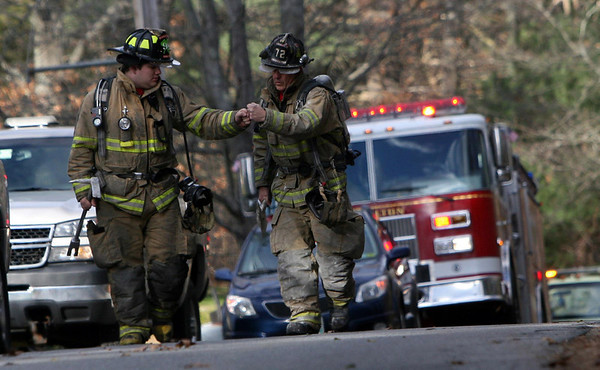 ALLEGRA BOVERMAN/Staff photo. Gloucester Daily Times. Essex: Hamilton firefighters arrive to assist at the scene of a fire at 72 Belcher Street in Essex on Friday afternoon.